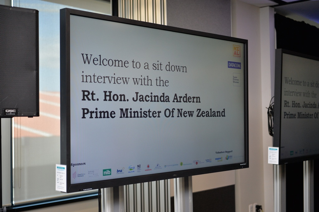 Screen sign that welcomes audience to an NZAL event