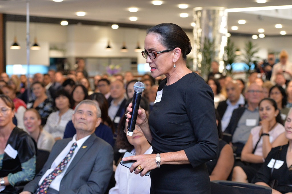 Traci Houpapa asking a question